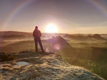 Hiker girl stay in strong Sun rays with many flares around her body