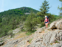 Hiker girl trekking Royalty Free Stock Photography