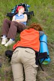 Hiker girls sleeping on backpacks Stock Photography