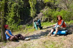 Hiker girls takes a rest Royalty Free Stock Image