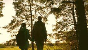 Hiker Girs in a pine forest. The tourist enjoys life and nature. vacation adventure travel. Happy family travels. mother stock footage