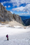 Hiker on the glacier climbing towards the summit of Zugspitze Royalty Free Stock Images