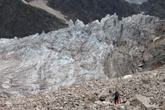 Hiker on glacier moraine Royalty Free Stock Image