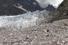 Hiker on glacier moraine Stock Photos