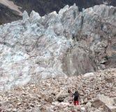 Hiker on glacier moraine Stock Photo