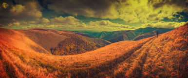 Hiker go by track on Borzhava ridge. Vintage Royalty Free Stock Photos
