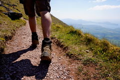Hiker going up mount brandon. Hiker walking up mount brandon in ireland Royalty Free Stock Photos