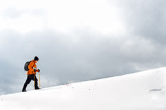 Hiker going up on a slope Stock Photos