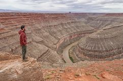 Hiker in Goosenecks State Park, Utah. USA. Royalty Free Stock Photos