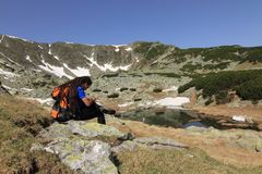 Hiker with gps. Hiker testing gps in Parang mountains, Romania Stock Photos