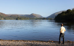 Hiker at Grasmere at dawn in Lake District Royalty Free Stock Photo