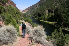 Hiker by Green River in Utah Stock Photography