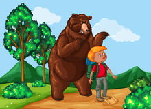 Hiker and grizzly bear in the park Royalty Free Stock Images