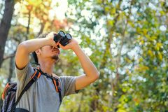 Hiker guy is looking in binoculars enjoying spectacular view Bird. Hiker guy is looking in binoculars enjoying spectacular view and Bird royalty free stock images
