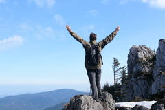 Hiker with hands up Stock Photography