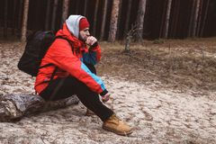 Hiker resting in the forest. Hiker have short respite on his way in the forest Royalty Free Stock Photography