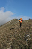 Hiker heading to the top of the mountain, mount Strega, Apennine Royalty Free Stock Images
