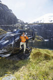 Hiker In Helicopter On Mountain Top Stock Photo