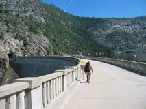 Hiker on Hetch Hetchy Dam. Hetch Hetchy dam in Yosemite National Park Royalty Free Stock Photography