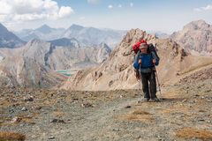 Hiker in high mountains. Stock Photos