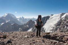 Hiker in high mountains. Royalty Free Stock Photos