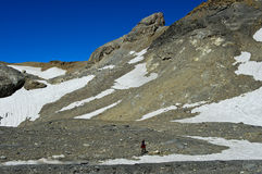 Hiker in the high mountains Stock Image