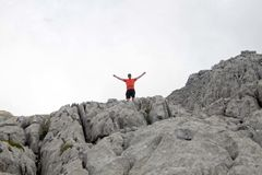 Hiker in the high of a rock in Pyrenees Stock Image