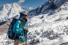 Hiker in highlands of Himalayas on Manaslu circuit Royalty Free Stock Photos