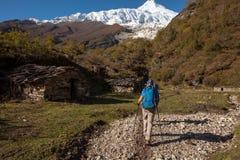 Hiker in highlands of Himalayas on Manaslu circuit Stock Images