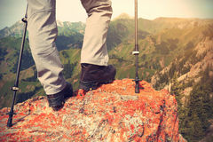 Hiker hiking on mountain peak cliff. Successful woman hiker hiking on mountain peak cliff royalty free stock images