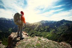 Hiker hiking on mountain top. Young woman hiker hiking on mountain top Royalty Free Stock Photo
