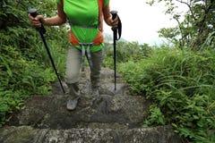 Hiker hiking on mountain trail Stock Photos
