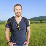 Hiker on the hillside Stock Photos