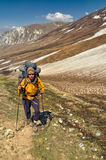 Hiker in Himalayas. Young hiker in scenic Himalayas mountains in Nepal Royalty Free Stock Image