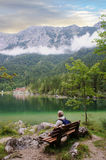A hiker at the Hintersee near Ramsau Royalty Free Stock Images