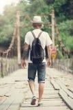 Hiker is crossing wooden bridge in Georgia. Hiker hipster is crossing wooden bridge in Georgia Stock Photos