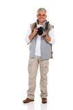 Hiker holding camera Stock Images