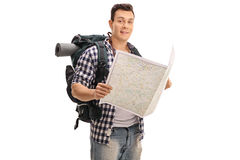 Hiker holding a generic map Royalty Free Stock Photo