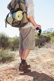 Hiker holding his binoculars on country trail Stock Photography