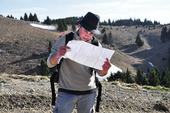 Hiker holding a map Stock Photo