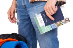 Hiker holding passport and tickets Stock Images