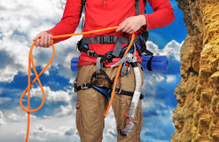 Hiker holding rope Stock Images