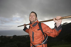 Hiker Holding Stick Across Shoulders On Hillside Stock Photos