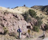 A Hiker at the Huachuca Mountain Crest Trail Trailhead. SIERRA VISTA, ARIZONA, MARCH 25. The Huachuca Mountain Crest Trail on March 25, 2017, near Sierra Vista Royalty Free Stock Photography