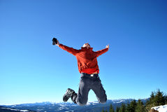 Hiker jump Stock Images
