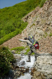 Hiker jumping Stock Images