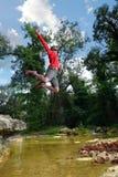 Hiker jumping Stock Photos