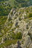 Hiker jumping and running between rocks at Jelasnica gorge Stock Image
