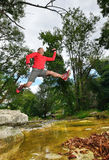 Hiker jumping two Royalty Free Stock Image