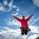 Hiker jumps in  mountains Stock Images